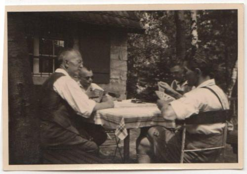 guys-playing-cards-table-outside-cabin-woods-old-vintage-photo-snapshot-r7657-9d63cbad06e8b691b4c578e3cb8ee5e4